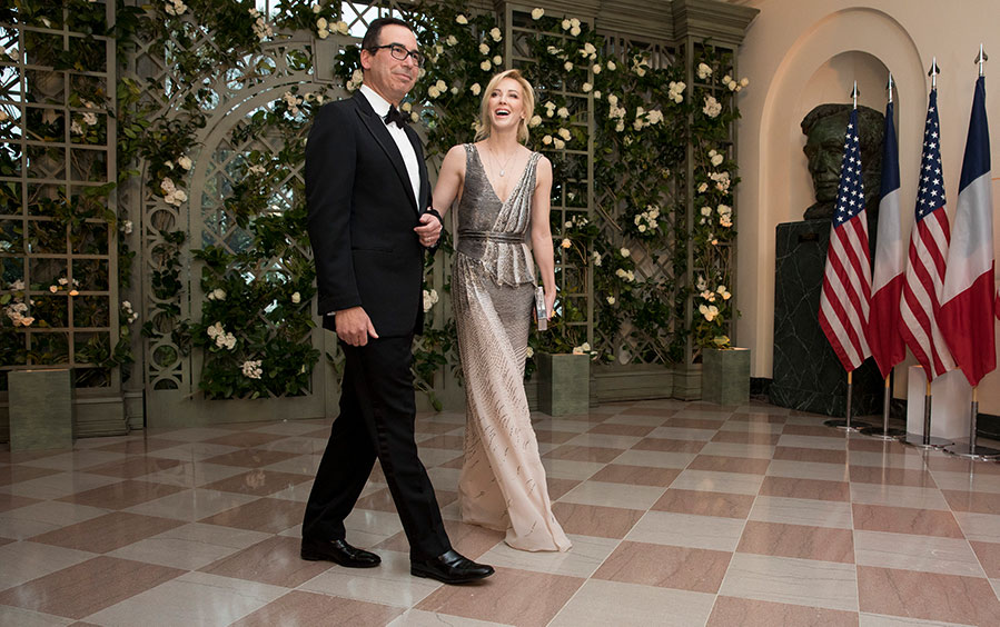 Treasury Secretary Steven Mnuchin and his wife Louise Linton arrive at the White House.