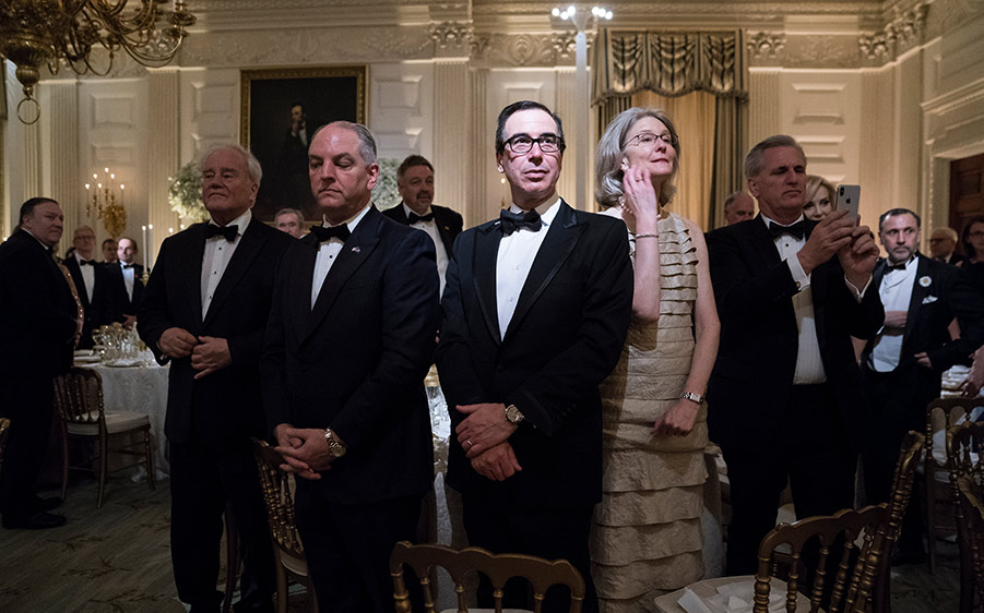Treasury Secretary Steve Mnuchin stands with others at a State Dinner in honor of France.