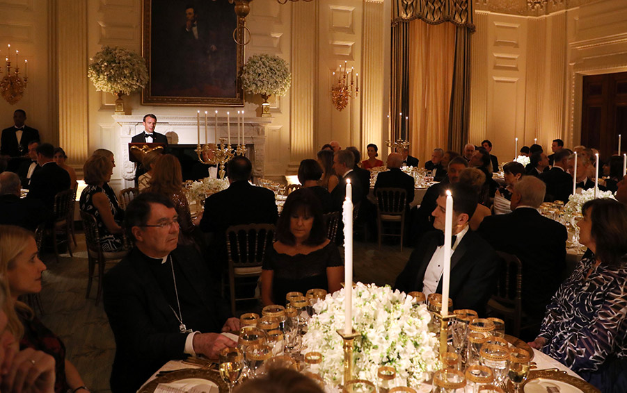 French President Emmanuel Macron speaks during a State Dinner in his honor at the White House in Washington, DC, April 24, 2018.