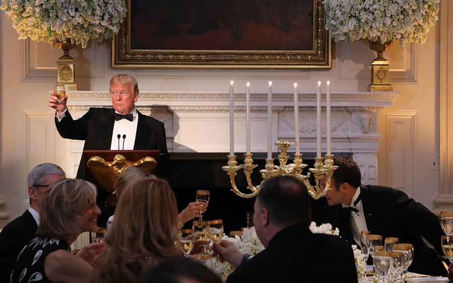 US President Donald Trump toasts French President Emmanuel Macron during a State Dinner in honor of Macron at the White House.