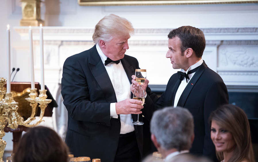 President Donald J. Trump shares a toast with French President Emmanuel Macron during a State Dinner for Macron and his wife Brigitte Macron at the White House.