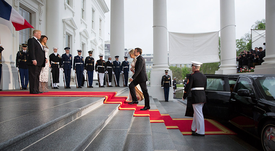 French President Emmanuel Macron and French first lady Brigitte Macron arrive at the North Portico before a State Dinner with U.S. President Donald Trump and first lady Melania Trump at the White House.
