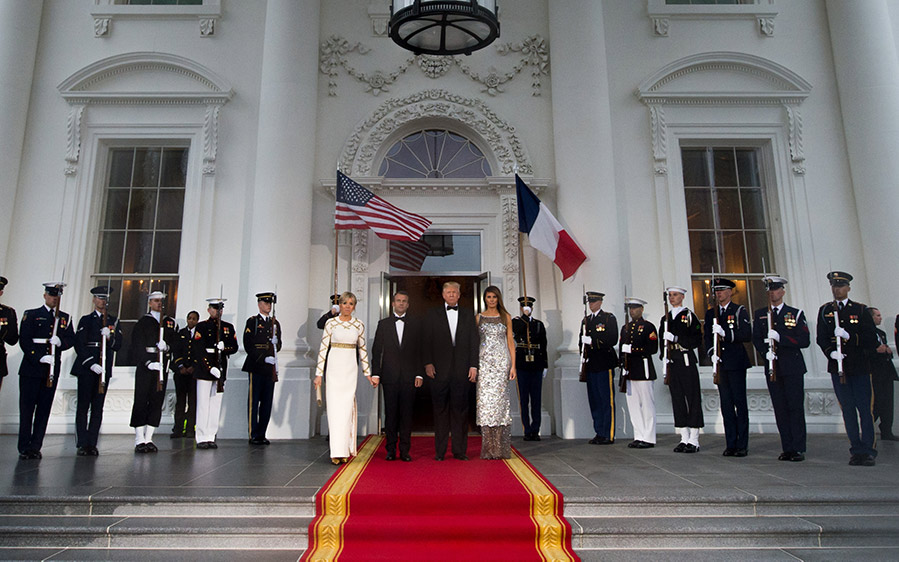 US President Donald Trump and First Lady Melania Trump welcome French President Emmanuel Macron and his wife, Brigitte Macron, as they arrive.