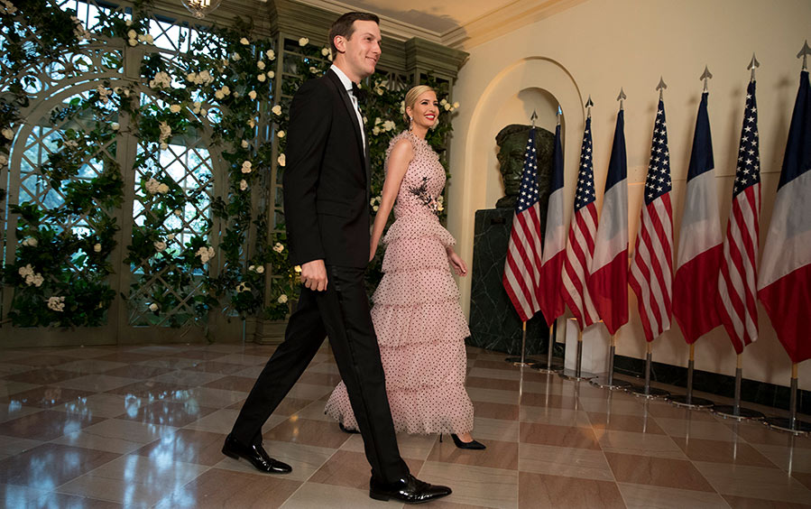 Jared Kushner and Ivanka Trump arrive at the White House.