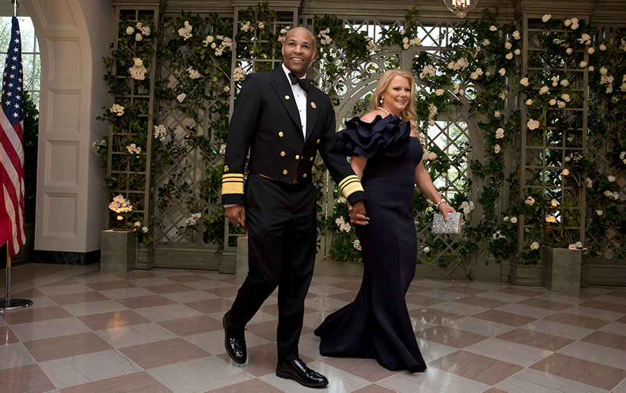 U.S. Surgeon General Jerome Adams and his wife Stacey arrive at the White House.
