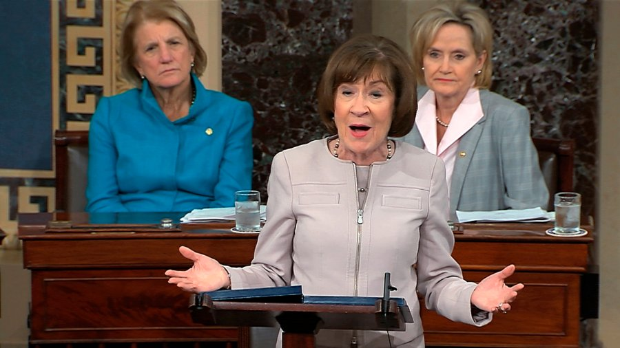In this image from video provided by Senate TV, Sen. Susan Collins, R-Maine., speaks on the Senate floor about her vote on Supreme Court nominee Judge Brett Kananaugh, Friday, Oct. 5, 2018, in the Capitol in Washington. Sen Shelly Capito, R-W.Va., sits rear left and Sen. Cindy Hyde-Smith, R-Miss., sits right.