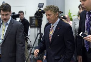 Sen. Rand Paul, R-Ky., center, speaks to reporters following a briefing on Syria on Capitol Hill in Washington, Friday, April 7, 2017. Amid measured support for the U.S. cruise missile attack on a Syrian air base, some vocal Republicans and Democrats are reprimanding the White House for launching the strike without first getting congressional approval.