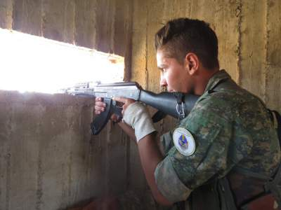 A member of the Syriac Military Council fighting at the Manbij frontline to cut ISIS off from Turkey.