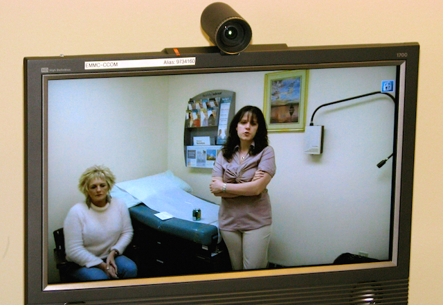 "In the growing trend of telemedicine, a physician remotely examines a patient via a webcam. Telemed abortions involve non-prescribing medical staff providing Mifeprex following the ""exam"" via the internet. (Photo: USDA / Flickr)"