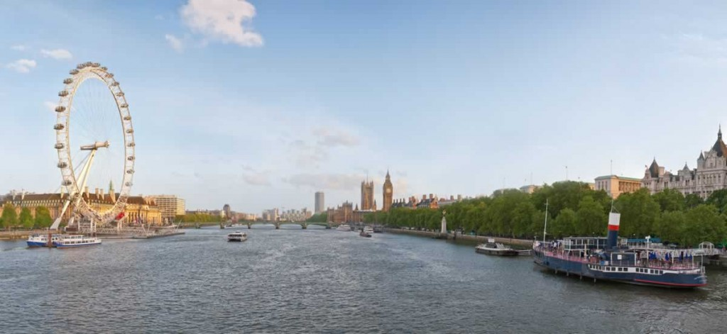 A panoramic view of the Thames facing upstream towards the south. The London Eye and London Aquarium is visible on the left, Houses of Parliament are visible beyond Westminster Bridge on the centre-right and the government buildings of Whitehall run along the banks on the right side.(Photo by DAVID ILIFF. License: CC-BY-SA 3.0)