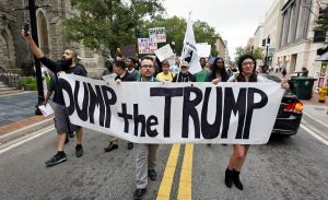 Anti-Trump protesters start their hike from Hemming Park to their announced destination at the offices of The Florida Times-Union newspaper, Saturday, Nov. 12, 2016, in Jacksonville, Fla.