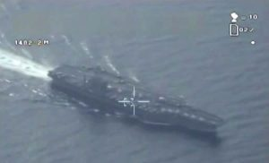 "This still image made from video broadcast on Iranian State television, friday, Jan. 29, 2016 shows what purports to be drone footage of a U.S. aircraft carrier. Iran flew a surveillance drone over a U.S. aircraft carrier and took ""precise"" photographs of it as part of an ongoing naval drill, state media reported Friday. The U.S. Navy said an unarmed Iranian drone flew near a French and American carrier earlier this month, but couldn't confirm it was the same incident.(Iranian State Television via AP) IRAN OUT"