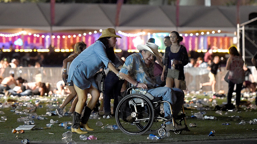 A man in a wheelchair is taken away from the Route 91 Harvest country music festival after gun fire was heard on October 1, 2017 in Las Vegas, Nevada.