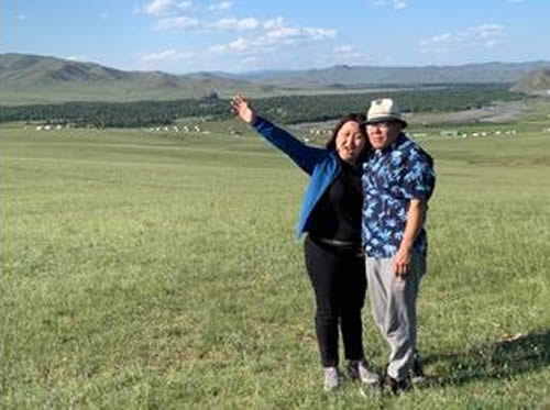 Yanjmaa and Khudree Jutmaan on the property they purchased for the retreat center.