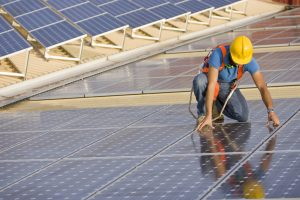 Image of a worker supervising a photovoltaic installation (ISO 100) . All my images have been processed in 16 Bits and transfer down to 8 before uploading.