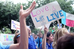 Austin, TX, USA - July 8, 2013:  Pro-life demonstrators express their position outside the Capitol.  Demonstrations were triggered by State Senator Wendy Davis' 11 hour filibuster to block Senate Bill 5, a measure intended to further restrict abortions.