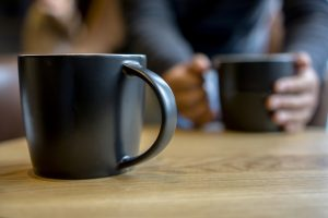 black coffee cup on table, chatting and dating
