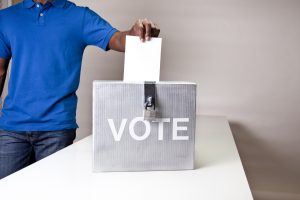Black man casing his vote in an election.  XXL converted from RAW.  MORE LIKE THIS... in lightboxes below!
