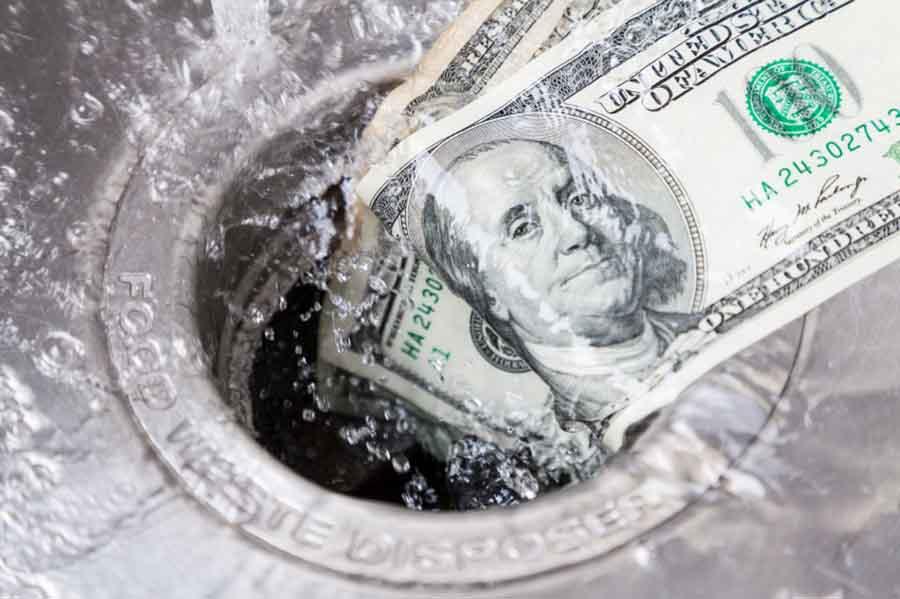 money_down_the_drain.jpg