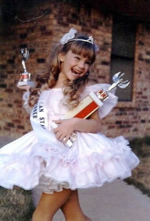 Jennifer McGill's first pageant. Seven years old.
