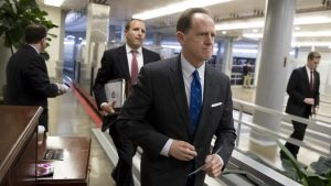 Sen. Pat Toomey, R-Pa., a member of the Senate Budget Committee, heads to the floor during a series of votes at the Capitol in Washington, Thursday, Oct. 19, 2017.